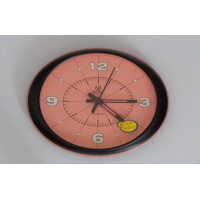 Oval orange wall clock