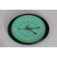 Oval green wall clock